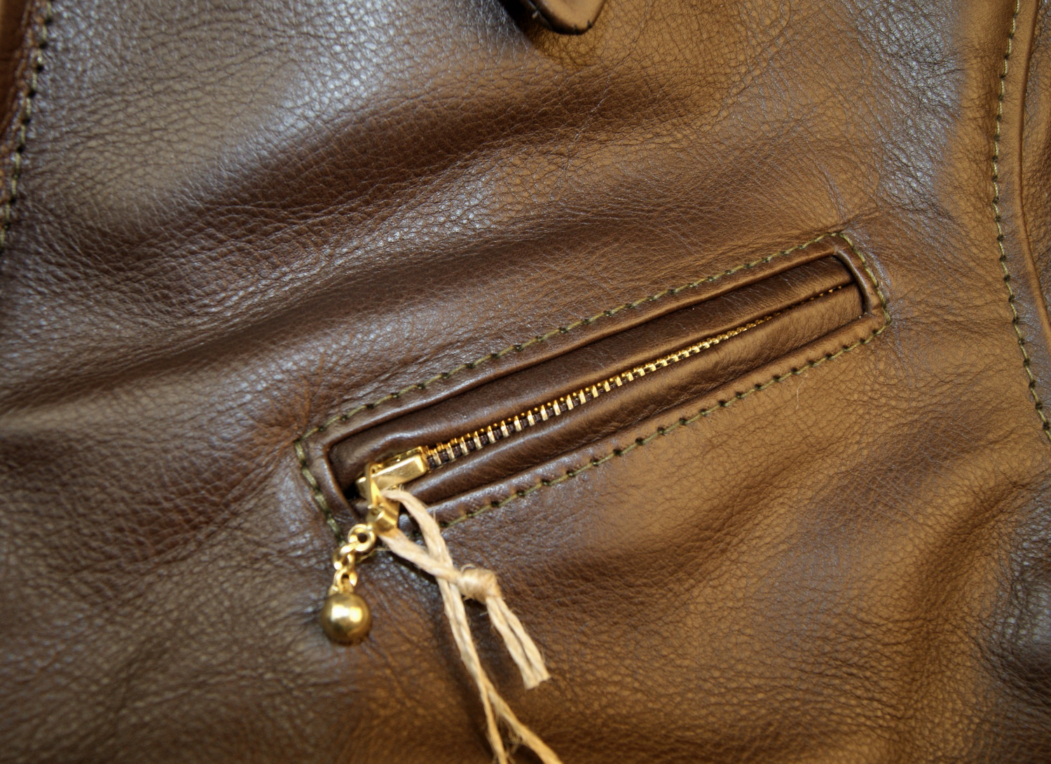Aero Premier Highwayman Seal Vicenza Horsehide DWM chest pocket.jpg