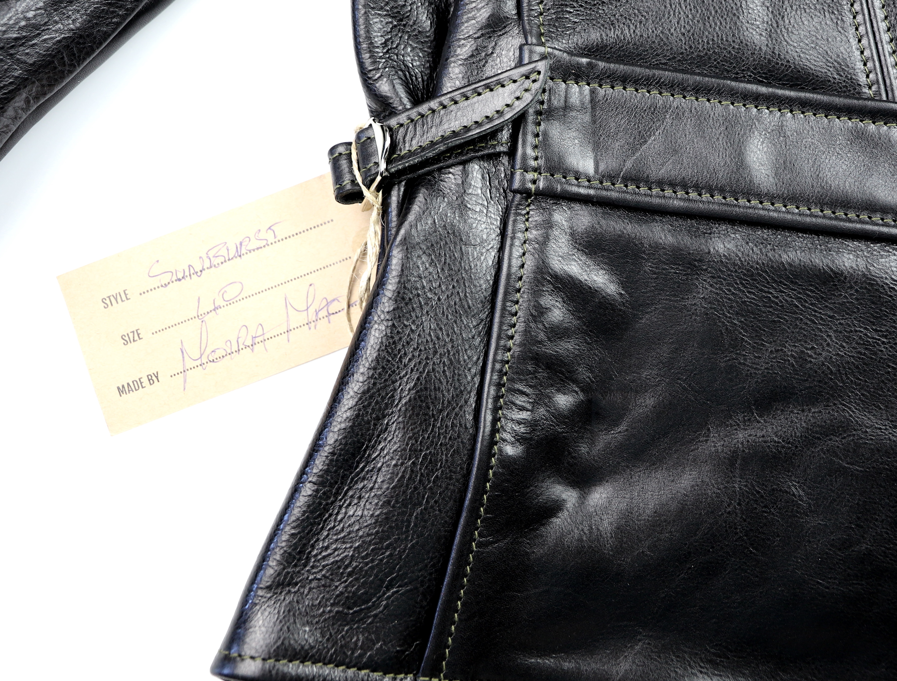 Aero Sunburst Black Badalassi Cowhide name tag.jpg