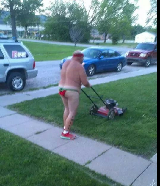 mowing grass in thong.jpg