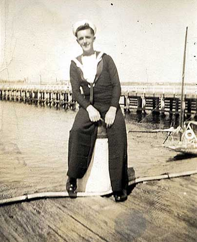 RN rating in No.1 tiddly suits -- note horiz creased trousers.jpg
