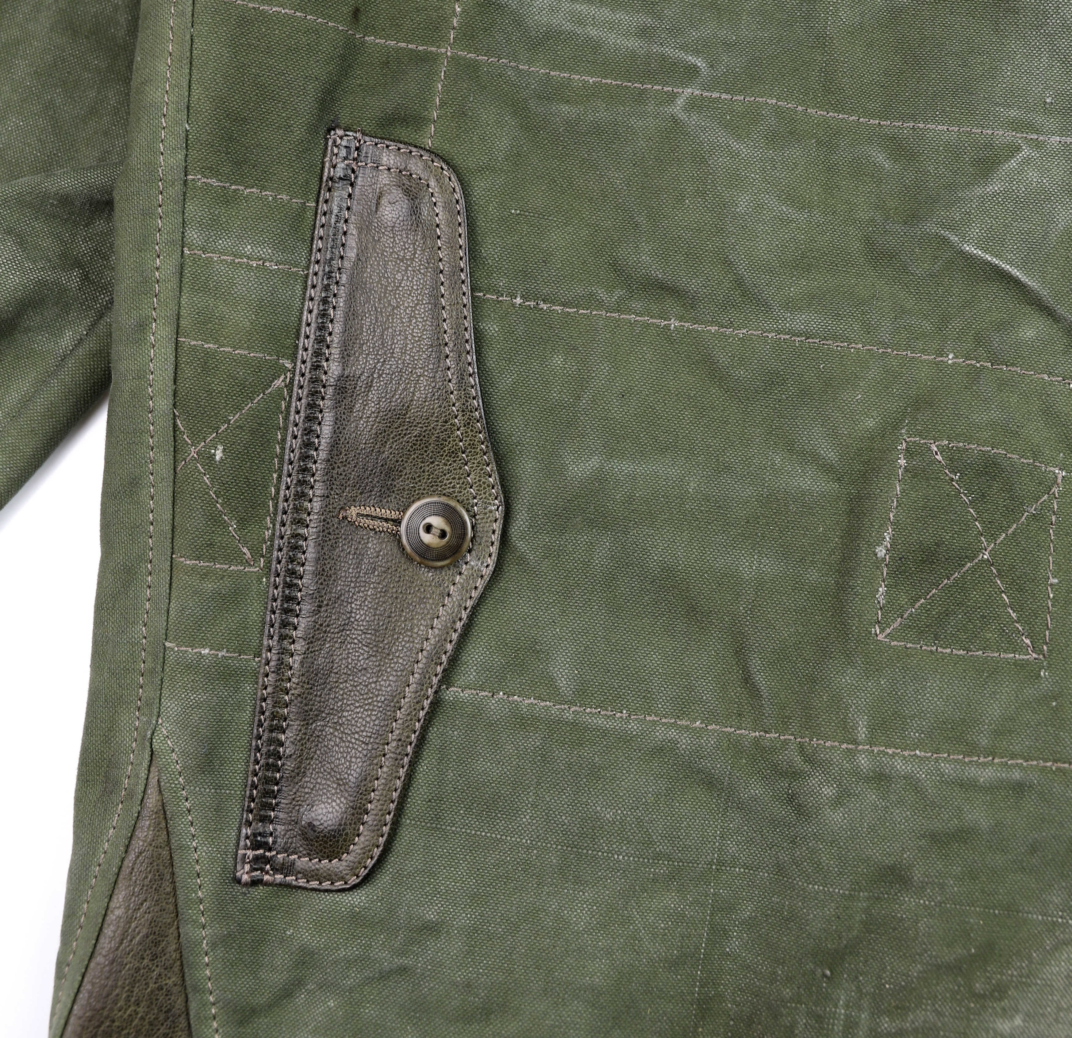 Thedi Canvas and Green Goatskin Button-Up map pocket.jpg
