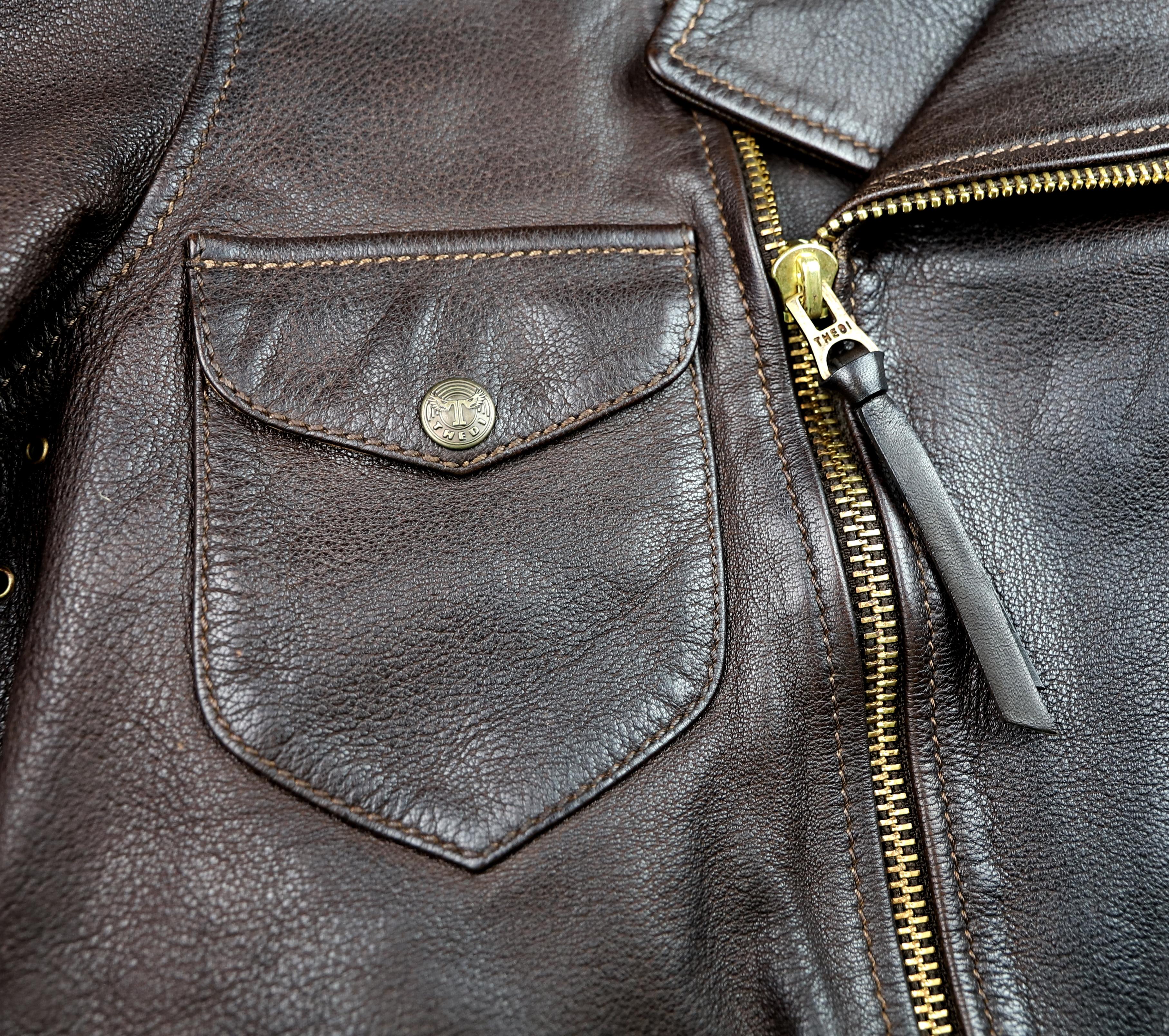 Thedi Evander Crosszip Half Belt Brown Goatskin MWC chest pocket.jpg