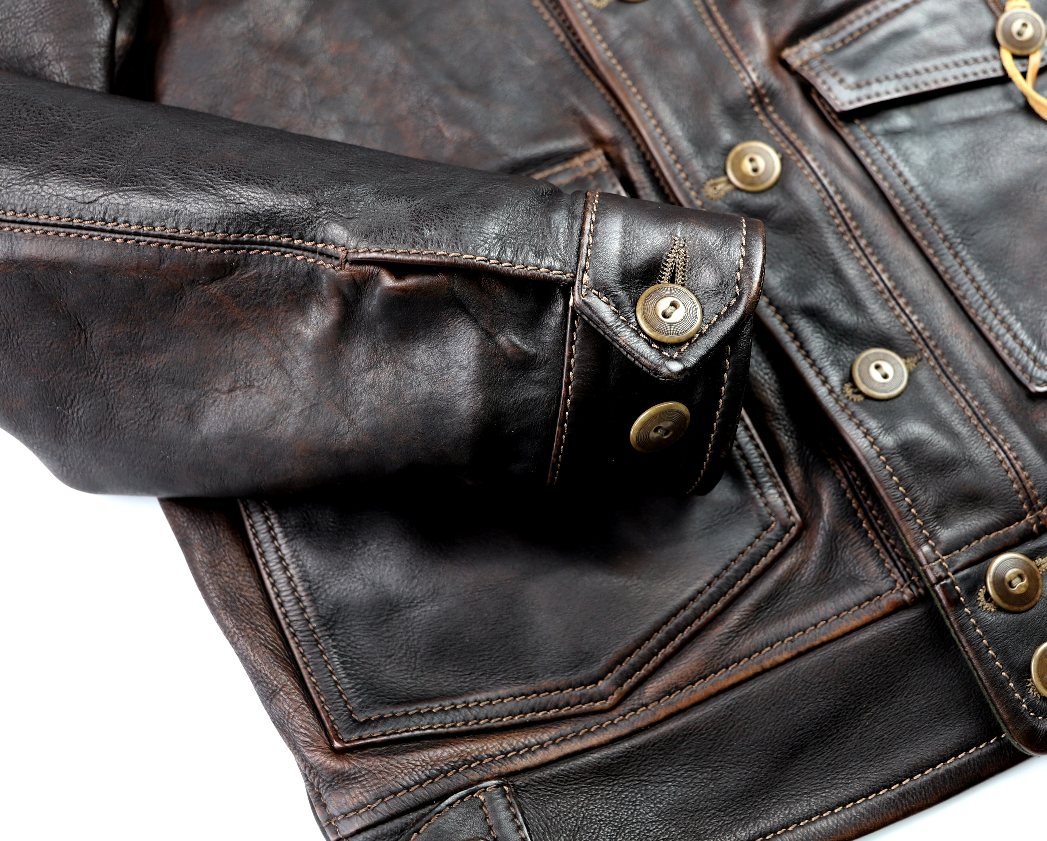 Thedi Niko Button-Up Hand-Dyed Brown Cowhide JG1 button cuff.jpg